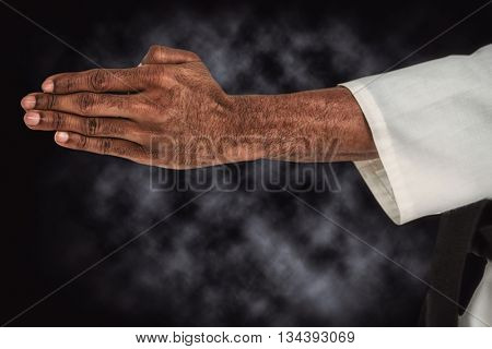 Close up view oh hands against dark background