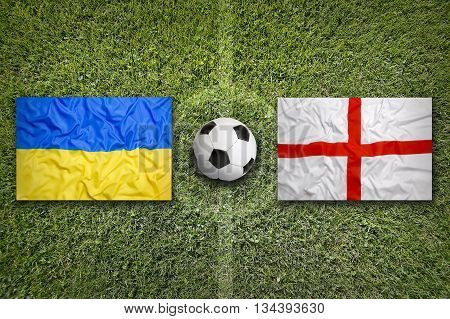 Ukraine Vs. England Flags On Soccer Field