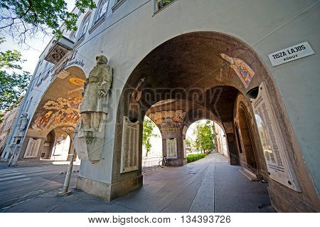 SZEGED HUNGARY - MAY 22 2016: Historic building in Szeged Hungary framed in city traffic.