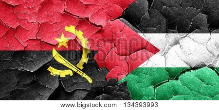 Angola flag with Palestine flag on a grunge cracked wall