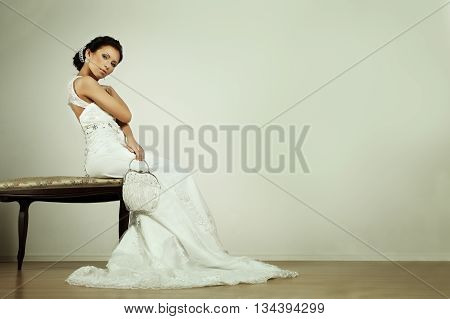 Fashion glamour bride in evening gown beauty portrait