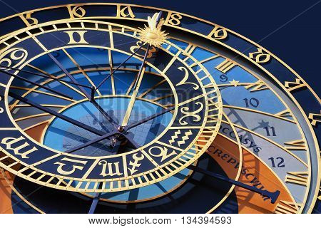 Fragment of famous antique arrow clock with horoscope tower in Prague