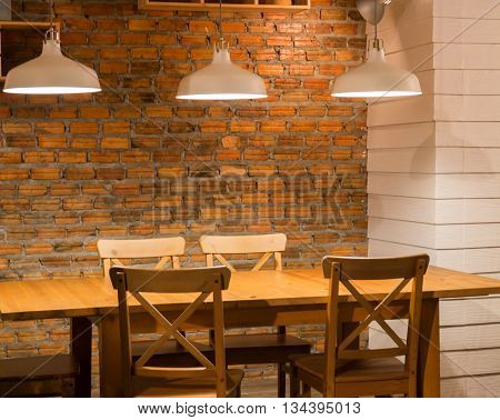 Vintage light bulb over wooden table stock photo