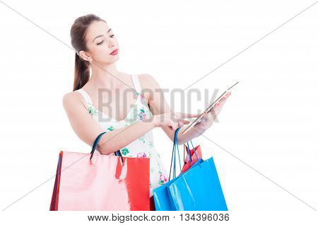 Young Lady At Shopping Checking Or Banking On Tablet