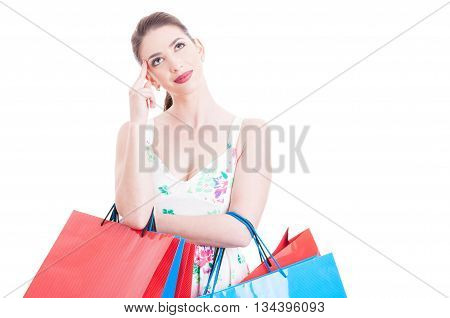 Woman Shopper Looking Up Smiling And Feeling Pensive