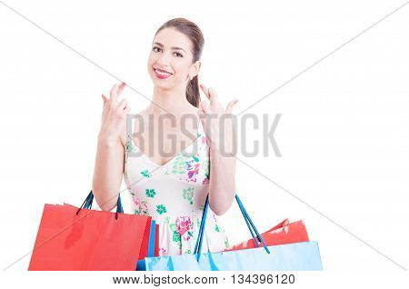 Pretty Lady Holding Shopping Bags Making Crossed Fingers Gesture