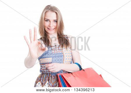 Portrait Of Smiling Shopper With Paper Bags Showing Ok Sign
