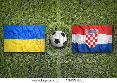 Ukraine Vs. Croatia Flags On Soccer Field