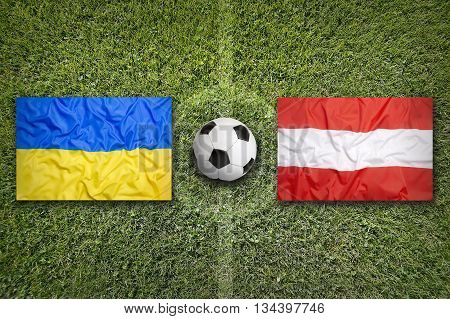 Ukraine Vs. Austria Flags On Soccer Field