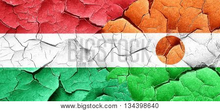 Hungary flag with Niger flag on a grunge cracked wall