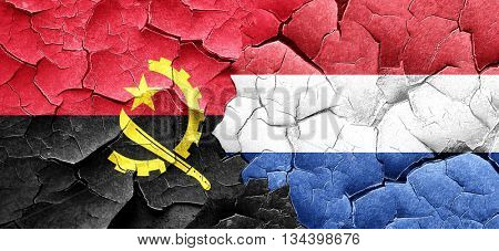Angola flag with Netherlands flag on a grunge cracked wall