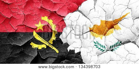 Angola flag with Cyprus flag on a grunge cracked wall