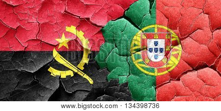 Angola flag with Portugal flag on a grunge cracked wall