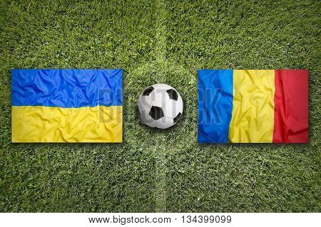 Ukraine Vs. Romania Flags On Soccer Field