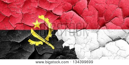Angola flag with Indonesia flag on a grunge cracked wall