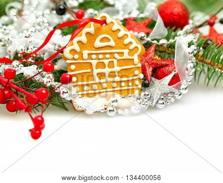 Christmas house from cookie and Xmas decor on white background