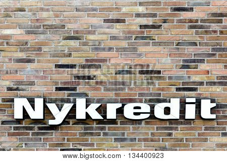 Viby, Denmark - June 11, 2016: Nykredit sign on a wall. New Credit called Nykredit in danish is one of Denmark's leading financial services companies