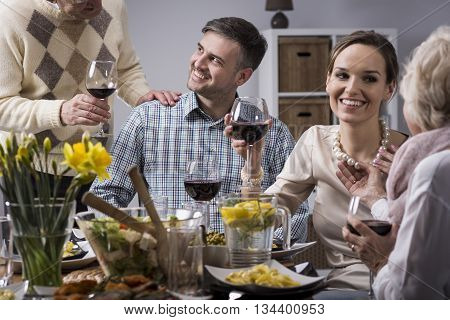 Family conversation during elegant meal at the table