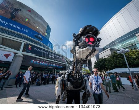 LOS ANGELES - June 14, 2016: Horizon Zero Dawn game machine monster character greeting gaming industry people crowd in front of E3 2016 Electronic Entertainment Expo entrance.