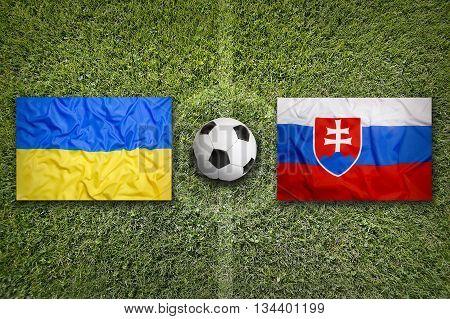Ukraine Vs. Slovakia Flags On Soccer Field