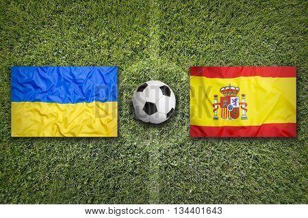 Ukraine Vs. Spain Flags On Soccer Field