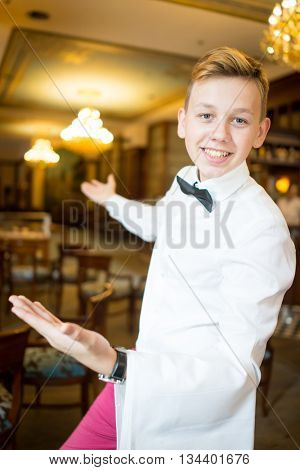 Waiter in restaurant saying welcome