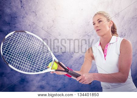 Athlete playing tennis with a racket against low angle view of sky