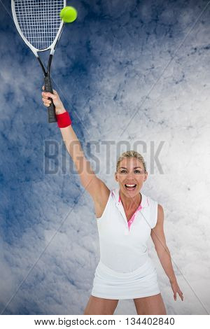 Athlete celebrating after victory against low angle view of sky