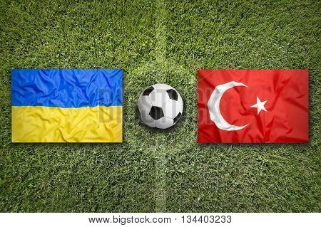 Ukraine Vs. Turkey Flags On Soccer Field