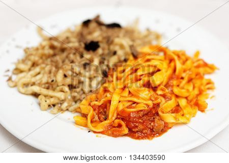 Pastas with black truffle and tomato sauce in plate