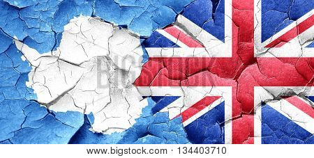 antarctica flag with Great Britain flag on a grunge cracked wall