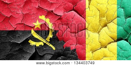 Angola flag with Guinea flag on a grunge cracked wall