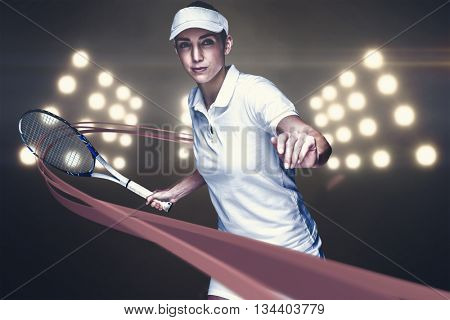 Female athlete playing tennis against digitally generated image of spotlight