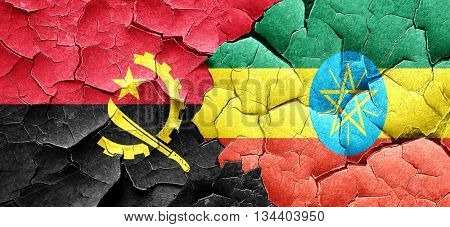 Angola flag with Ethiopia flag on a grunge cracked wall