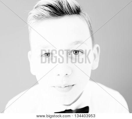High key portrait of a boy