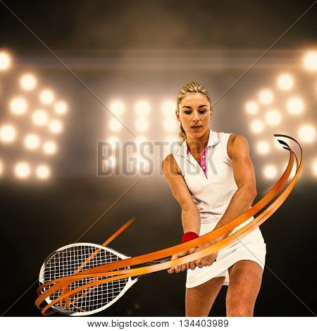 Athlete playing tennis with a racket against digitally generated image of spotlight
