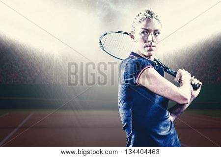 Tennis player playing tennis with a racket against digitally generated image of luminous tennis court