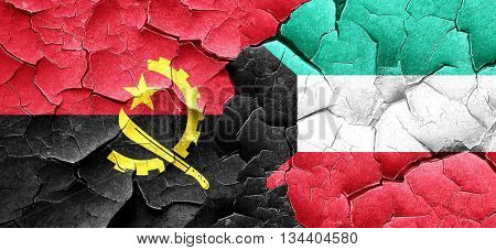 Angola flag with Kuwait flag on a grunge cracked wall