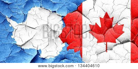 antarctica flag with Canada flag on a grunge cracked wall