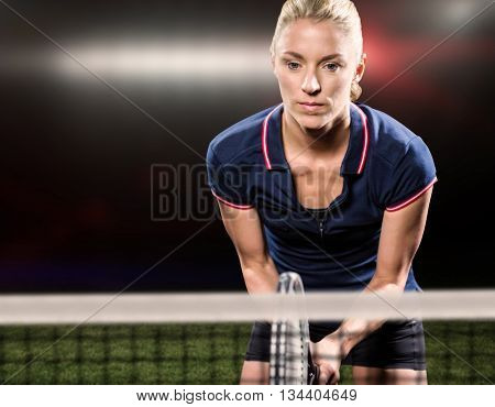 Tennis player playing tennis with a racket against american football arena