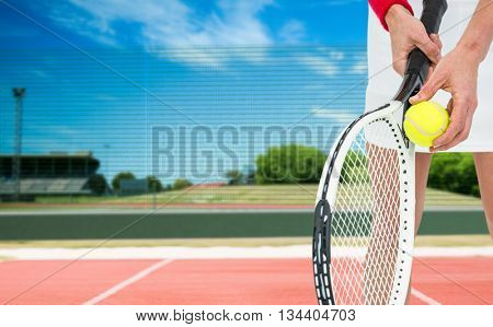 Athlete holding a tennis racquet ready to serve against composite image of soccer field
