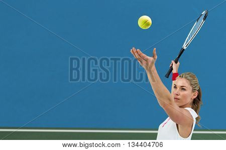 Athlete holding a tennis racquet ready to serve against digitally generated image of bi colored background