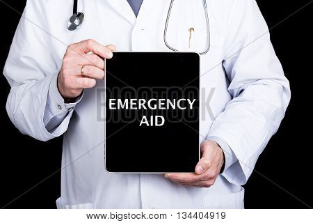 technology, internet and networking in medicine concept - Doctor holding a tablet pc with emergency aid sign. Internet technologies in medicine and tourism.