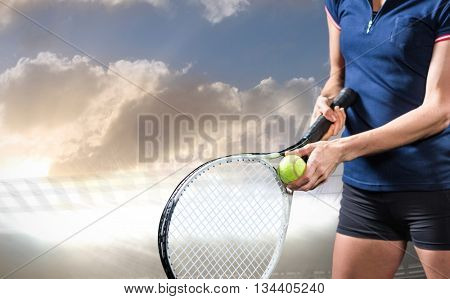 Tennis player holding a racquet ready to serve against sports arena