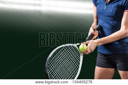 Tennis player holding a racquet ready to serve against spotlight