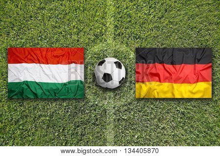 Hungary Vs. Germany Flags On Soccer Field
