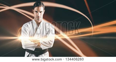 Portrait of fighter standing on black background against black background