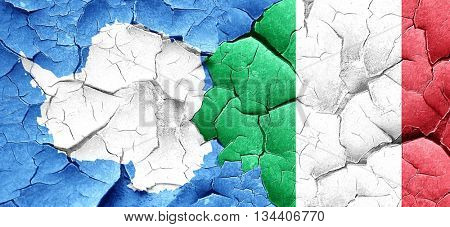 antarctica flag with Italy flag on a grunge cracked wall