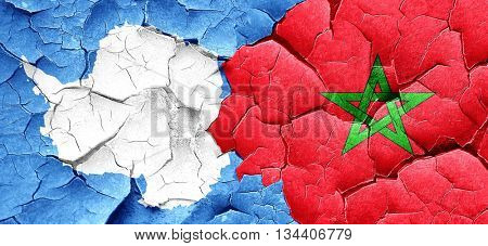 antarctica flag with Morocco flag on a grunge cracked wall