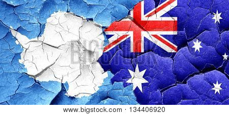 antarctica flag with Australia flag on a grunge cracked wall